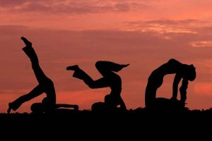 Yoga For Stress Relief Silhouettes Doing Yoga