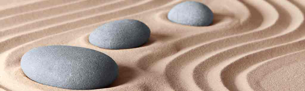pebbles amidst sand art symbolising stability