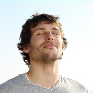 Man Using Breathing Awareness Techniques