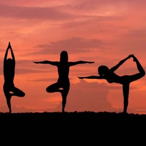 Yoga For Stress and Trauma Relief Silhouettes Doing Yoga